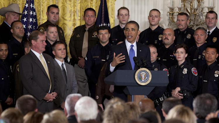 President Barack Obama gestures during remarks at an event to honor the 2013 National Association of Police Organizations TOP COPS award winners in the East Room of the White House on Saturday, May 11, 2013, in Washington. (AP Photo/Evan Vucci)