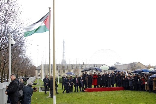 Palestinian President Abbas, UNESCO Director General Bokova and officials attend flag-raising ceremony for Palestinian flag at UNESCO Headquarters in Paris