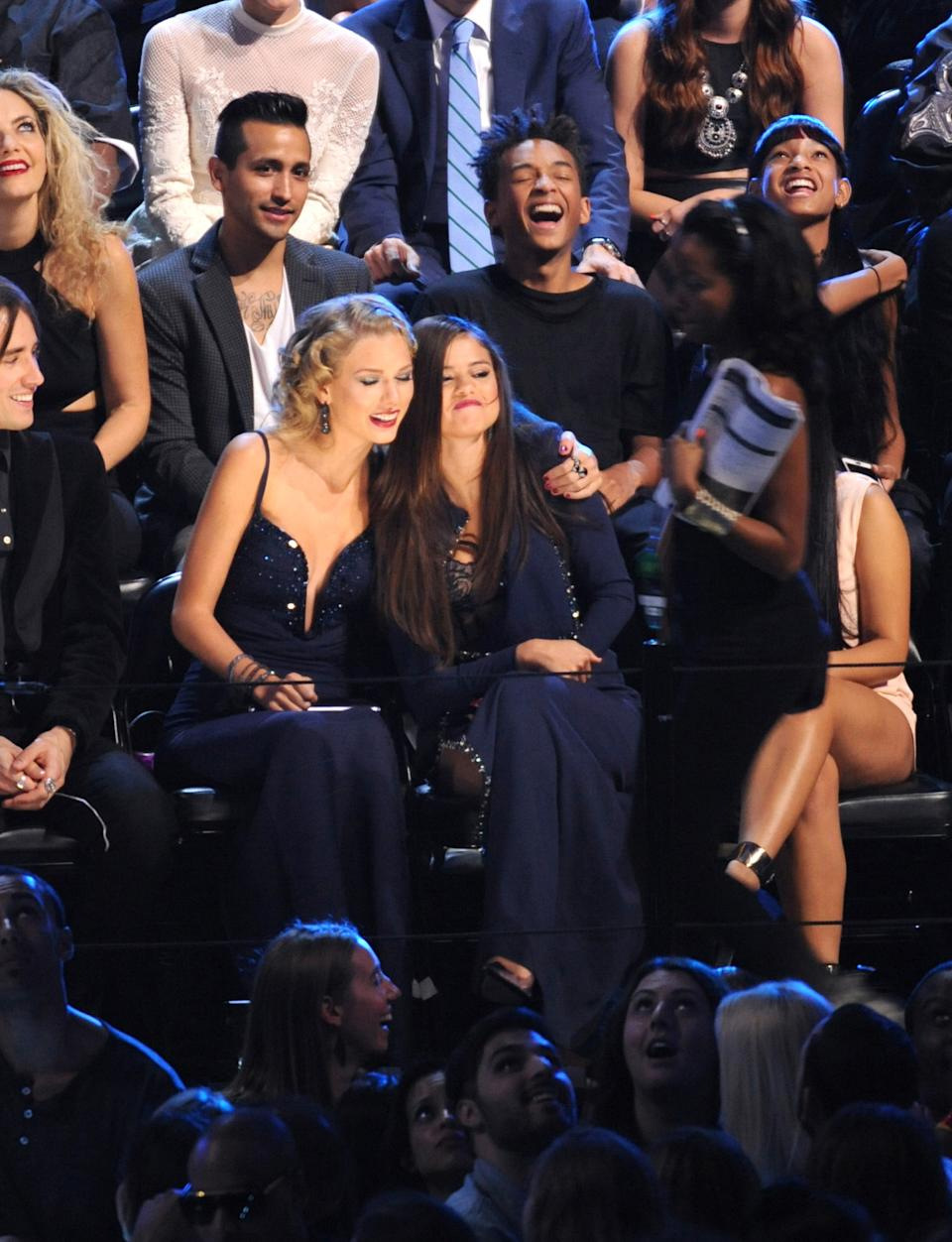 Taylor Swift, center left, and Selena Gomez sit together at the MTV Video Music Awards on Sunday, Aug. 25, 2013, at the Barclays Center in the Brooklyn borough of New York. (Photo by Scott Gries/Invision/AP)