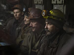 Ukrainian coal miners wait in a room before going underground …