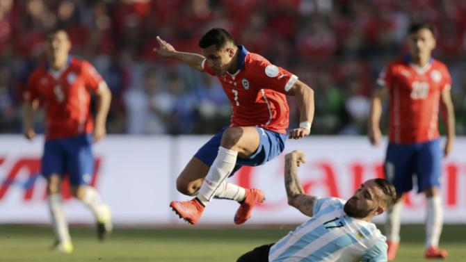 Chile's Sanchez is tackled by Argentina's Otamendi during their Copa America 2015 final soccer match at the National Stadium in Santiago