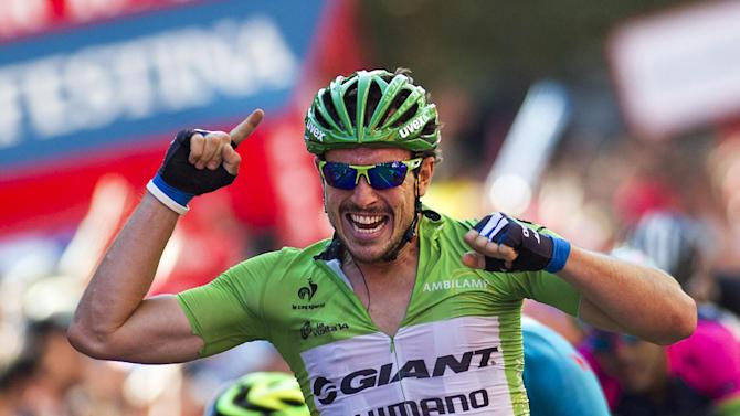 "Giant Shimano's German cyclist John Degenkolb celebrates after winning the 12th stage of the 69th edition of ""La Vuelta"" Tour of Spain, on September 4, 2014"