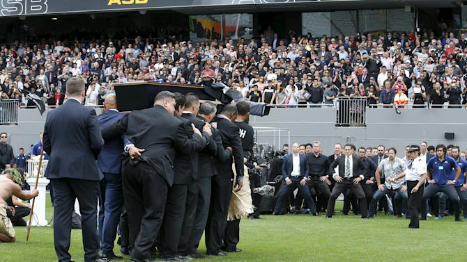 Former and present All Black's (R) watch as former All Black Jonah Lomu's casket is carried out of Eden Park during his memorial service in Auckland