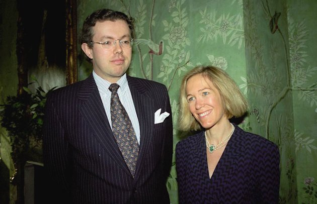This photo of Nov. 26, 1996 shows Eva Rausing, right, and her husband Hans Kristian Rausing at Winfield House, London, the residence of the US ambassador to the UK attending the Glamour America Fashion Show and lunch. One of Britain&#39;s richest women, American-born Eva Rausing, was found dead in her west London home and a man was arrested in connection with the case, British police say, adding that an autopsy had failed to uncover a formal cause of death. Rausing, 48, was the wife of Hans Kristian Rausing, heir to the TetraPak fortune his father built by creating a successful manufacturer of laminated cardboard drink containers. (AP Photo/Alan Davidson/The Picture Library Ltd)