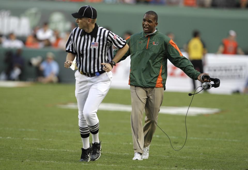 University of Miami head coach Randy Shannon argues a pass interference call against Miami with a referee in the second quarter during an NCAA college football game against Virginia Tech in Miami, Saturday, Nov. 20, 2010. (AP Photo/Lynne Sladky)