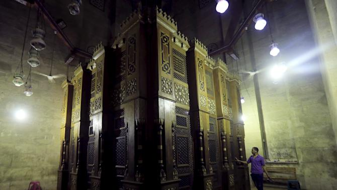 "An Egyptian man prays at the shrine of Al-Refaie after the ""Al Zohar"" afternoon prayers during the holy month of Ramadan inside Al-Refaie mosque in the old Islamic area of Cairo"