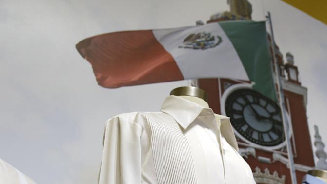 """In this Wednesday, Oct. 17, 2012 photo, a guayabera from the 1970s in Mexico worn by then-president Luis Echevarria is on display at an exhibition titled """"The Guayabera: A Shirt's Story"""" at the Museum of History Miami, in Miami. This is the first exhibition to trace the story of the shirt's evolution through Cuba, Mexico, and the United States. (AP Photo/Lynne Sladky)"""