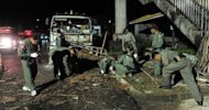 Bomb squad members inspect the site of a bomb blast in Thailand&#39;s Narathiwat province on September 28. Bombing and shooting attacks have killed six people and left 27 wounded across the restive Thai south in two days of violence in the insurgency-plagued region, police said Sunday
