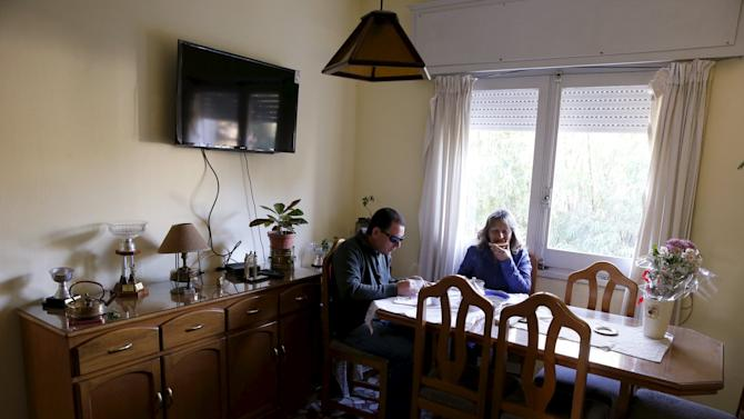 Laura Paipo, first blind principal in Uruguay and her husband Jorge Albarracin take breakfast at their home in Montevideo