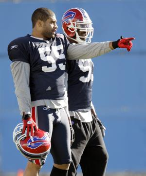 Buffalo Bills' Shawne Merriman (55) talks with Bills' Reggie Torbor (53) during NFL football practice in Orchard Park, N.Y., Wednesday, Nov. 10, 2010. Merriman  limped off the field with a lower right leg injury shortly after opening his first practice with his new team. (AP Photo/David Duprey)
