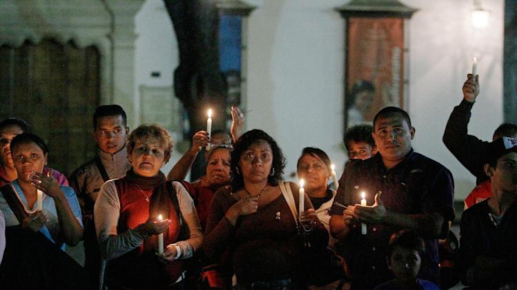 People hold candles during a vigil in support of Venezuela's President Hugo Chavez in Caracas, Venezuela, Thursday, Dec. 13, 2012. Chavez is recovering favorably despite suffering complications during cancer surgery in Cuba, his vice president Nicolas Maduro said Thursday amid uncertainty over the Venezuelan leader's health crisis and the country's political future. (AP Photo/Fernando Llano)
