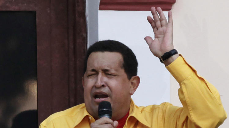 Venezuela's President Hugo Chavez sings on a balcony of Miraflores presidential palace in Caracas, Venezuela, Thursday, July 28, 2011. Chavez sang on a balcony of the presidential palace as he celebrated his 57th birthday before a crowd of supporters, vowing to overcome cancer. (AP Photo/Ariana Cubillos)