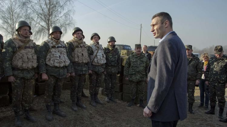 UDAR (Punch) party head Klitschko speaks to Ukrainian soldiers during a military exercise near Zhytomyr