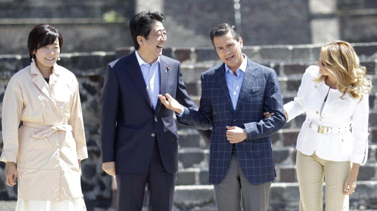 Japan's first lady Akie Abe, Japan's Prime Minister Shinzo Abe, Mexico's President Enrique Pena Nieto and Mexico's first lady Angelica Rivera pose for a picture during a tour the Teotihuacan archaeological site