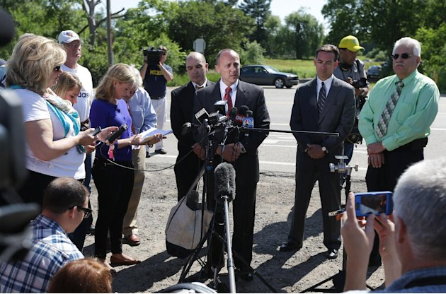 Robert Foley, center, special agent in charge of the FBI's Detroit division, addresses the media in Oakland Township, Mich., Wednesday, June 19, 2013 where he announced the FBI was ending the search o