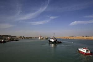 Dredger float on a new section of the Suez canal during …