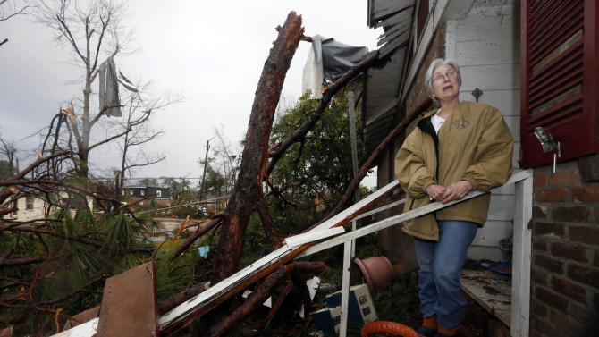 Marie Key, 68, said she is hoping to salvage what she can Monday morning, Feb. 11, 2013 at her Hattiesburg, Miss., home following Sunday's tornado. She was alone in her one-story brick house when the storm hit and dove under a kitchen table, hitting her head. At least three trees hit her house, which she said was also damaged during Hurricane Katrina and another storm in 1998. (AP Photo/Rogelio V. Solis)
