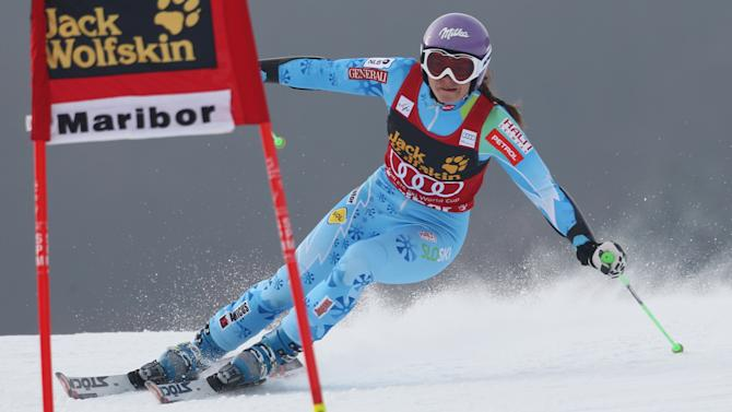 Slovenia's Tina Maze speeds past a gate on her way to clock the fastest time in an alpine ski, women's World Cup giant slalom, in Maribor, Slovenia, Saturday, Jan. 26, 2013. (AP Photo/Marco Trovati)
