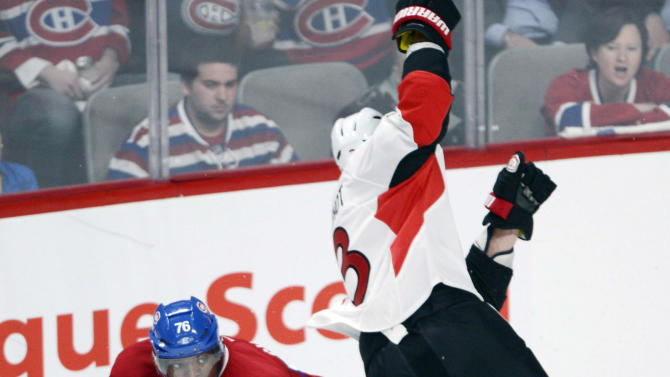 Montreal Canadiens defenceman P.K. Subban (76) and Ottawa Senators defenceman Marc Methot collide during second-period NHL hockey Game 2 first-round playoff action in Montreal, Friday, May 3, 2013. (AP Photo/The Canadian Press, Ryan Remiorz)