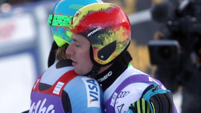Austria's Marcel Hirscher, right, embraces Ted Ligety of Unites States  at the end of an alpine ski, men's World Cup giant slalom in Adelboden, Switzerland, Saturday, Jan.12, 2013. (AP Photo/Alessandro Trovati)