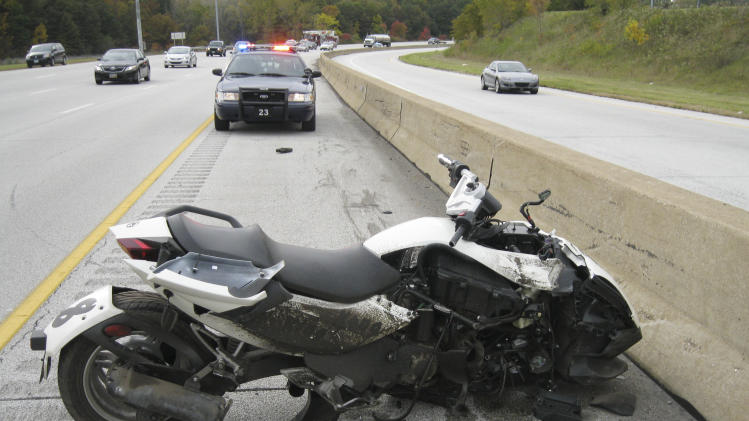 In this released by the Brooklyn (Ohio) Police Department, shows the damaged motorcycle ridden Cleveland Browns defensive end Marcus Benard  that crashed on Monday, Oct. 10, 2011 in Brooklyn, Ohio. Benard, who broke his hand in the wreck, has been charged with driving under suspension and reckless operation. Brooklyn Police Sgt. Scott Mielke said Benard is due in court Oct. 18 in Parma. (AP Photo/Brooklyn Police Department)