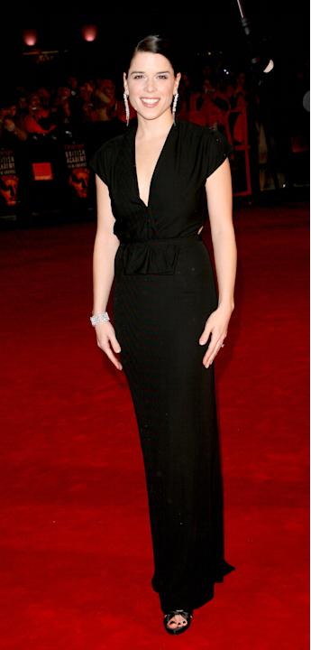 Neve Campbell in a black column gown