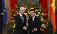 European Union President Herman Van Rompuy (L) shakes hands with Vietnamese President Truong Tan Sang during a welcoming ceremony at the presidential place in Hanoi. International pressure mounted on Vietnam to uphold human rights when the EU raised the issue after the jailing of two musicians on charges of anti-state propaganda in the communist nation