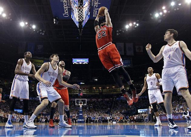 Chicago Bulls forward Taj Gibson (22) goes up for a dunk in front of Oklahoma City Thunder forward Kevin Durant (35), center Steven Adams (12), guard Russell Westbrook (0) and forward Nick Collison (4