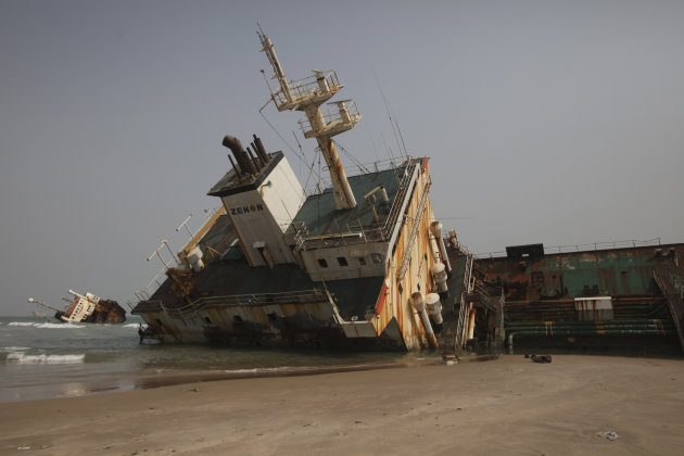 In this photo taken Thursday, March 15, 2012, The rusting hulk of an abandoned petroleum ship is beached on the coastline in Lagos, Nigeria, as the powerful waves of the Atlantic Ocean crash against the ships that lay beached along the coastline just outside of Nigeria's largest city. Government officials say they don't know how many abandoned ships choke Nigeria's waterways outside of Lagos with the resulting environmental and navigational hazards, as well as highlighting the lawlessness and corruption surrounding daily life in Nigeria. (AP Photos/Sunday Alamba)