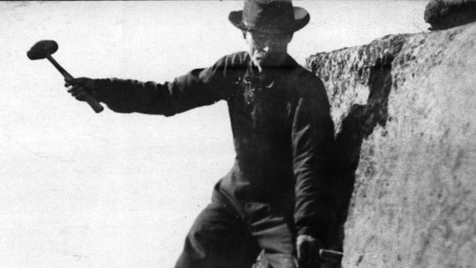 In this 1916 photo provided by the Littleton Area Historical Society, Edward Geddes works on anchoring turnbuckles on the Old Man of the Mountain in Franconia, N.H. Geddes, a stone quarry superintendent from Quincy, Mass., was the first man to do repair work on New Hampshire's iconic figure, which fell nearly ten years ago. (AP Photo/Littleton Area Historical Society, Rev. Guy Roberts)
