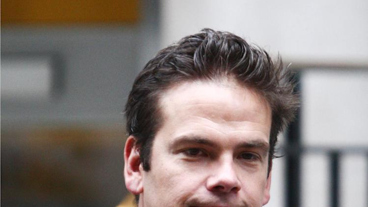 Lachlan Murdoch leaves the home of his father Rupert in London, Monday, July 18, 2011. James Murdoch scaled the rungs of the global media empire that his father built. Now scandal taints the heir apparent, threatening to derail the expected succession and shaking the notion that the Murdoch dynasty would preserve its tight grip over the multibillion-dollar business. (AP Photo/Steve Parsons/PA)UNITED KINGDOM OUT - NO SALES - NO ARCHIVES