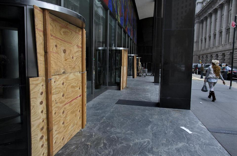 Plywood covers the revolving doors in preparation for Hurricane Sandy at the 2 Broadway building of Lower Manhattan in New York, Sunday, Oct. 28, 2012. Areas along the Northeast Coast are preparing for the arrival of the hurricane and a possible flooding storm surge. (AP Photo/Craig Ruttle)