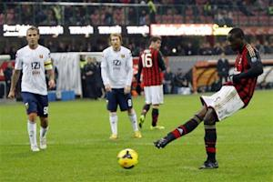AC Milan's Mario Balotelli takes a penalty which was saved during their Italian Serie A soccer match against Genoa at San Siro stadium in Milan
