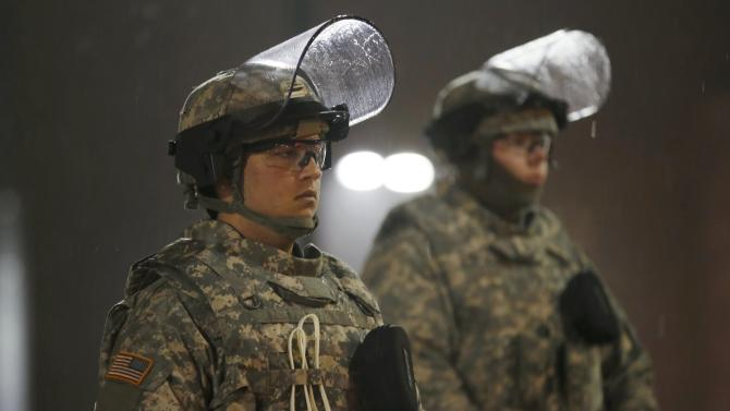 Missouri National Guardsmen stand guard at the Ferguson Police Station in Ferguson Missouri