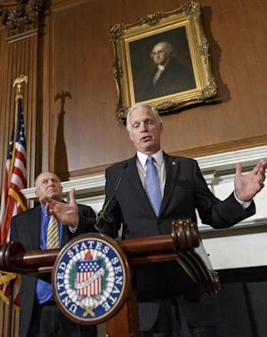 Sen. Ron Johnson, R-Wis., right, accompanied by attorney Rick Esenberg, left, announces that he has filed a lawsuit to block the federal government from helping to pay for health care coverage for members of Congress and their staffs, Monday, Jan. 6, 2014, during a news conference on Capitol Hill in Washington. Johnson says that members of Congress and their staffs are getting special treatment under the health care law. The lawsuit would would force Congress and its staffers to purchase their insurance from the federal health care exchanges without exemptions carved out by the Office of Personnel Management. (AP Photo/J. Scott Applewhite)