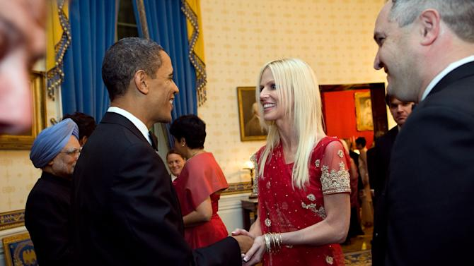 """FILE - This Nov. 27, 2009 file photo released by the White House  shows President Barack Obama greeting  Michaele and Tareq Salahi, right, at a State Dinner hosted by Obama  at the White House in Washington in this Nov. 24, 2009 file photo. The husband of """"Real Housewives of D.C."""" cast member Michaele Salahi reported to police that he believed his wife had been abducted, but investigators said Wednesday Sept. 14, 2011 she assured them she was with a friend and """"where she wanted to be."""" (AP Photo/The White House, Samantha Appleton,File)"""