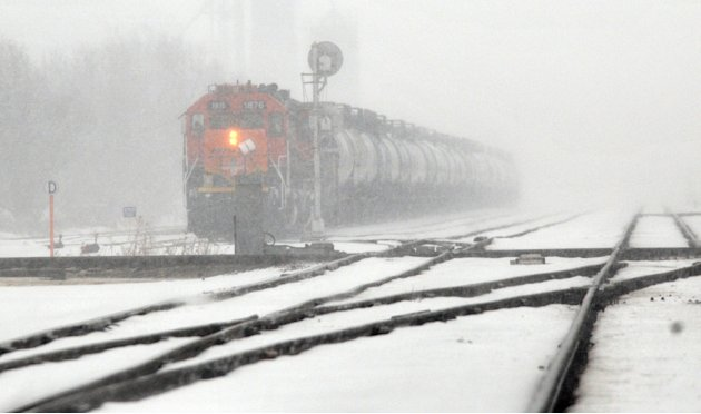 A BNSF train engine waits for another train to pass, Monday, Feb. 25, 2013, along Lorraine Street, just northeast of Avenue A in Hutchinson, Kan. Parts of Kansas are bracing for anywhere from 8 to 24