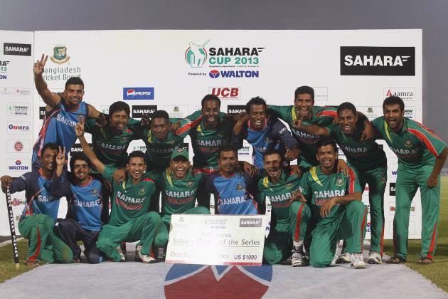Bangladesh's players celebrate after they whitewashed New Zealand in their One-day International (ODI) cricket series in Narayanganj