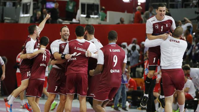 Qatar's players celebrate defeating Poland in their semi-final match of the 24th Men's Handball World Championship in Doha