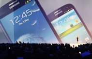 A display of tSamsung Electronics&#39; latest smartphone, the Galaxy S3, during a launch event in London on May 3, 2012