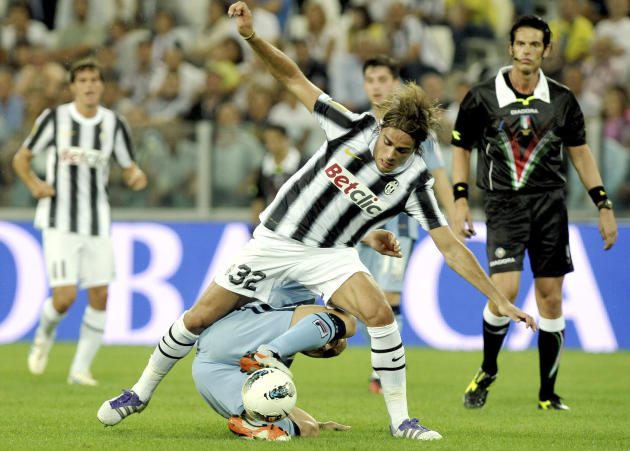 Juventus' Alessandro Matri, top, is challenged by Notts County's Neal Bishop during their friendly soccer match on the occasion of the inauguration of Juventus' new stadium in Turin, Italy, Thursday,