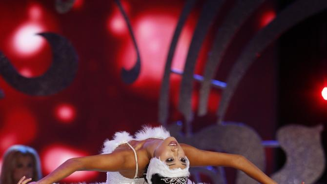 Miss America 2014 contestant, Miss California Crystal Lee dances during the talent portion of the 2014 Miss America Pageant in Atlantic City, New Jersey