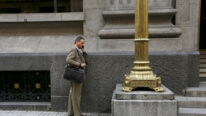 A man uses mobile phone outside of Chile's Central Bank