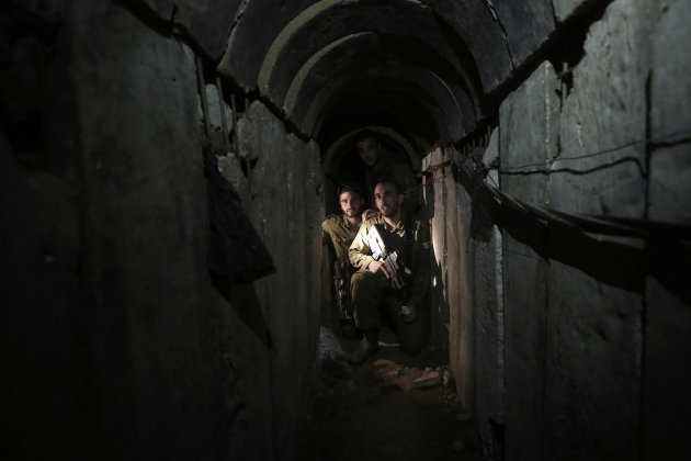 Israeli soldiers walk through a tunnel discovered near the Israel-Gaza border, Oct. 13, 2013. (AP/Tsafrir Abayov, File)