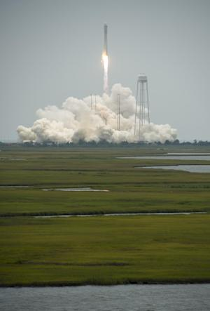 This photo provided by NASA, the Orbital Sciences Corporation Antares rocket launches with the Cygnus spacecraft onboard, Sunday, July 13, 2014, at NASA's Wallops Flight Facility in Virginia. The rocket will carry the Cygnus spacecraft filled with over 3,000 pounds of supplies to the International Space Station in the company's second contracted cargo delivery flight to the space station for NASA. (AP Photo/NASA, Bill Ingalls) MANDATORY CREDIT