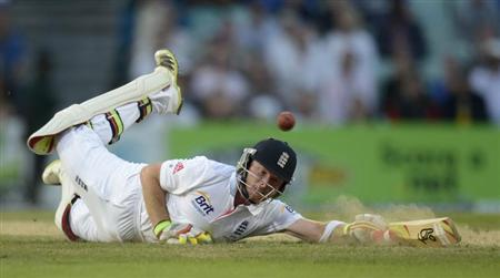 England's Bell dives into his ground during the fifth Ashes cricket test match against Australia at the Oval cricket ground, London