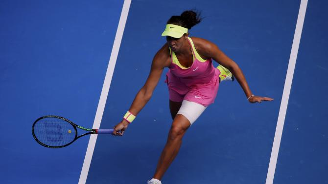 Keys of the U.S. runs to hit a return to compatriot Williams during their women's singles semi-final match at the Australian Open 2015 tennis tournament in Melbourne