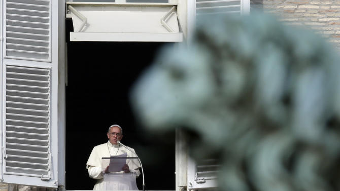 Pope Francis reads the list of 19 new Cardinals during the Angelus prayer in St. Peter's Square, at the Vatican, Sunday, Jan. 12, 2014. The pontiff has named his first batch of cardinals, choosing 19 men from Asia, Africa, North and South America and elsewhere, including Haiti and Burkina Faso, to reflect his attention to the poor. Francis made the announcement Sunday as he spoke from his studio window to a crowd in St. Peter's Square. (AP Photo/Gregorio Borgia)