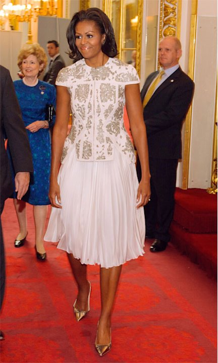 US First Lady Michelle Obama and US Ambassador Louis Susman attend a reception at Buckingham Palace for Heads of State and Government attending the Olympics Opening Ceremony on July 27, 2012 in London