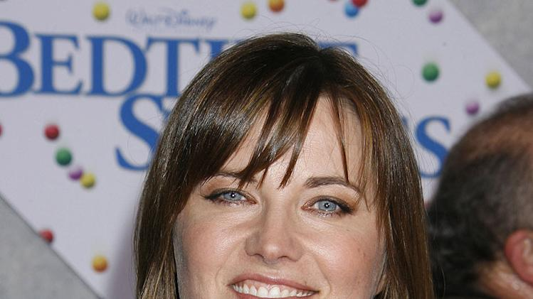 "Lucy Lawless arrives at the Los Angeles premiere of ""Bedtime Stories"" at the El Capitan Theatre on December 18, 2008 in Hollywood, California."
